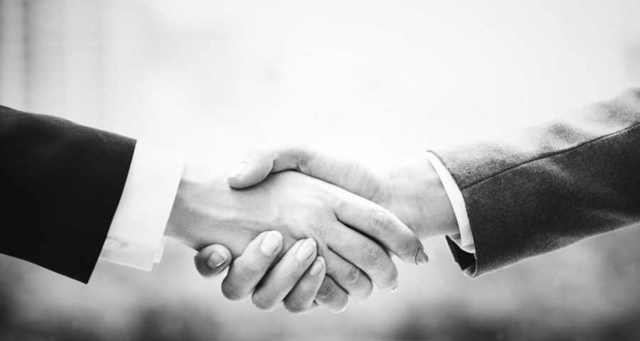 Black and white handshake with suites